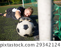 goalkeeper with ball at football goal on field 29342124