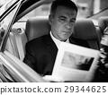 Businessman Working Busy Car Inside 29344625