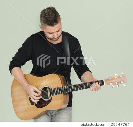 Caucasian Man Playing Guitar 29347764