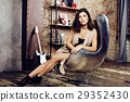 young pretty woman waiting alone in modern loft 29352430