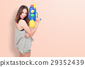 Girl holding a water gun 29352439