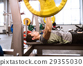 Hispanic man in gym working out with weights 29355030