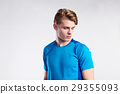 Young handsome hipster man in blue sports t-shirt 29355093