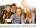 Teenagers at summer music festival, taking selfie 29355129