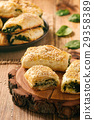 Puff pastry rolls  with spinach and ricotta. 29358389