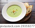 broccoli cream soup on wooden table 29359277
