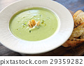 broccoli cream soup on wooden table 29359282