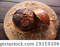 Beef Hamburger on wood background 29359306
