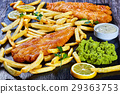 fish and chips on black slate plate 29363753