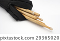 Drum sticks and black bags. 29365020