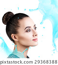 Young woman face in splashes of water. 29368388