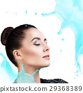 Young woman face in splashes of water. 29368389