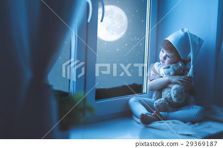 child girl at window dreaming starry sky 29369187