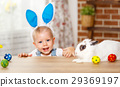 happy easter! happy baby boy playing with bunny. 29369197