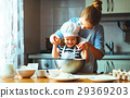 happy family in kitchen. mother and child preparin 29369203