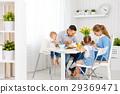 Happy family  at breakfast 29369471