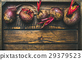 Raw organic purple beetroots in rustic wooden box 29379523