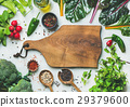 Fresh greens, raw vegetables and grains, wooden 29379600