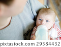 Father feeding newborn baby daughter with milk in 29384432