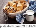 Fresh croissants basket and milk 29384828