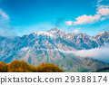 Clouds Over Rocks. Mountain Peaks Covered With 29388174