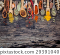 Various of spices and herbs in wooden spoons. 29391040