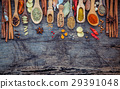 Various of spices and herbs in wooden spoons.  29391048