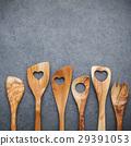 Various wooden cooking utensils border.  29391053