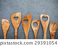 Various wooden cooking utensils border. 29391054