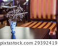 Dry flower in vase on wood table 29392419
