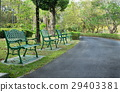 Green metal benches in the park 29403381