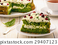 Spinach cake with cream and cranberries. 29407123