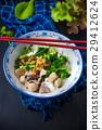 Bowl of asian noodles with vegetables and pak 29412624
