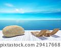 Beach lounge, sundeck over blue sea and sky 29417668
