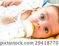 Baby and milk bottle 29418770