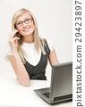 Pretty businesswoman making a phone call 29423897
