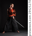 Man in kimono practicing with japanese sword 29425270