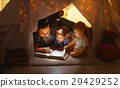 happy family father and children reading a book  in  tent at hom 29429252
