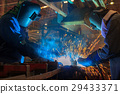 Team welder are welding in car factory 29433371