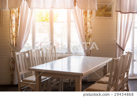 Table and chairs in house. 29434868