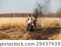 Enduro bike racer in a field 29437439
