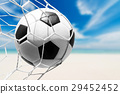 soccer ball in goal net with tropical beach 29452452