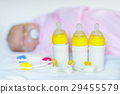 Cute newborn baby girl with nursing bottles and 29455579