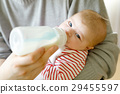 Father feeding newborn baby daughter with milk in 29455597