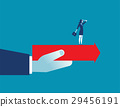 Hand holding arrow with businesswoman standing 29456191