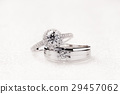 Bride and groom wedding engagement rings on white 29457062