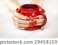 red manicure with a cup of tea 29458150