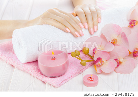 beautiful pink manicure with orchid, candle and 29458175