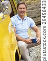 Handsome Man Drinking Tea Coffee in Camper Van Bus 29458433