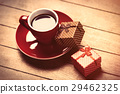 photo of red cup of coffee near dried cones 29462325
